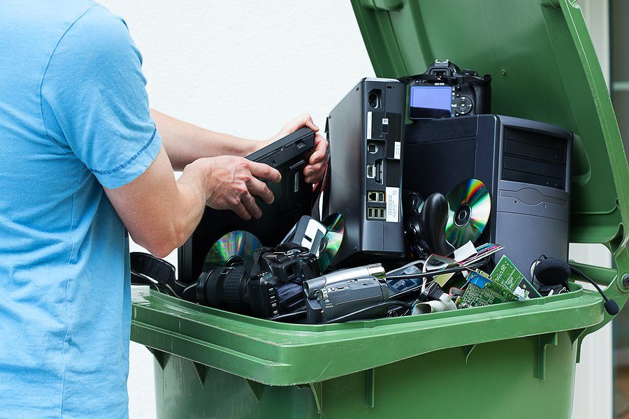 bigstock Man Discarding Old Electronics 47530123 1 - Before Tossing Those Electronic Gadgets Consider This